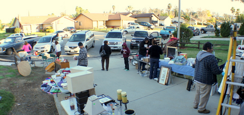 Garage Sale with cars and people