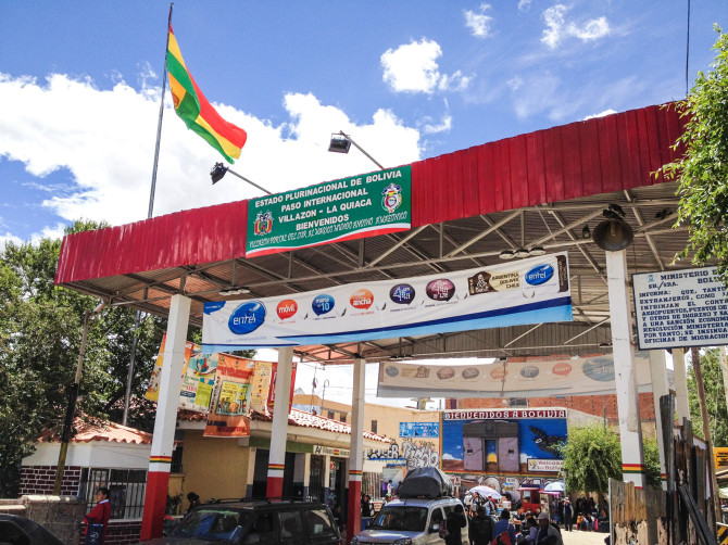 Border crossing with flag and building between Argentina and Bolivia at La Quiaca - Villazon