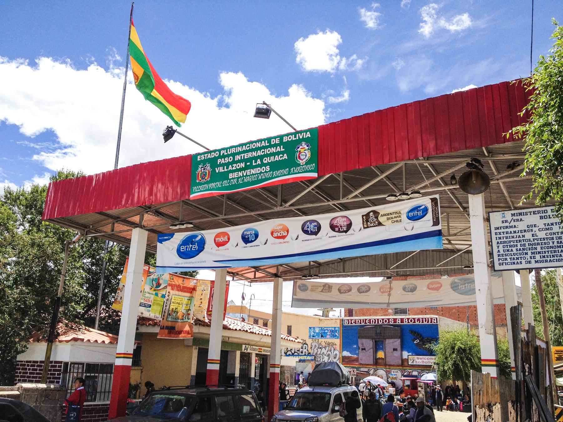 Border crossing with flag and building between Argentina and Bolivia at La Quiaca - Villazon