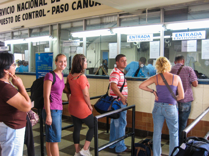 Alyssa waiting in line with a small backpack at the border crossing between Costa Rica and Panama