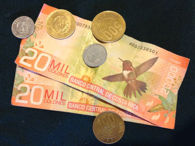 20 thousand colones bills paper money with butterfly design and coins from Costa Rica
