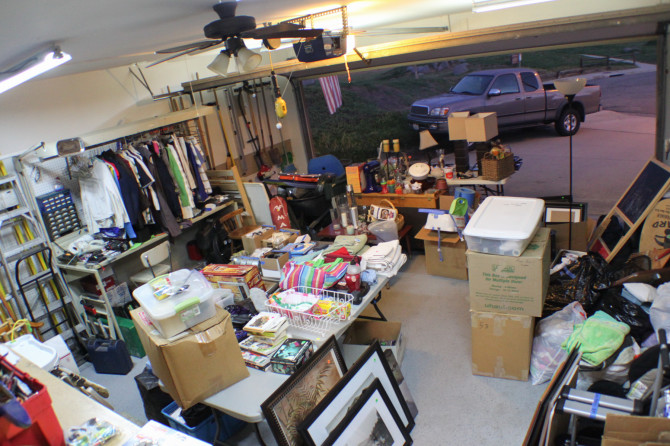 Garage filled with boxes, clothes, and tools - trying to decide how to sell everything you own