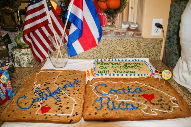 Cookie cakes at going away party with California map and Costa Rica map and flags