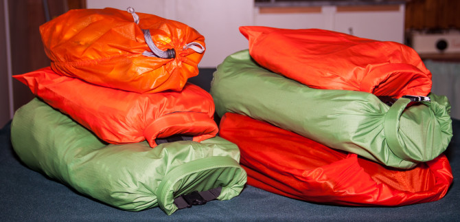 All clothes packed in two stacks of waterproof bags