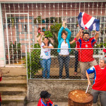Costa Rican wins world cup 2014 and Waving Flags in their front yard