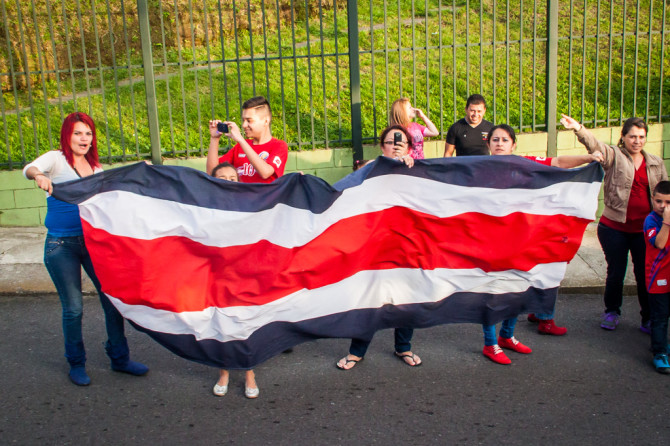 Costa Ricans Waving a huge Flag after winning the world cup against greece
