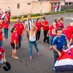 Costa Ricans celebrating winning world cup 2014 on side of road