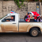 Costa Ricans celebrating winning world cup 2014 in back of pickup truck