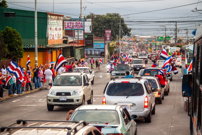 Costa Ricans celebrating winning the FIFA world cup 2014 street full of cars and people