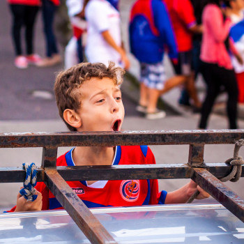 Little kid hanging out of car window yelling