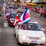 Costa Ricans celebrating winning world cup 2014 street full of cars and people
