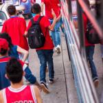 Kids banging on bus to celebrate winning soccer football futbol game