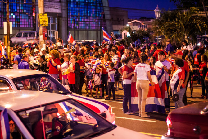Crowds of people in park celebrating Costa Rica winning world cup