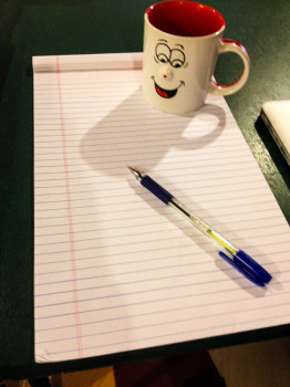 Pen Coffee Cup and Pad of Paper to Write Down Tips to Save Money Before Your big trip