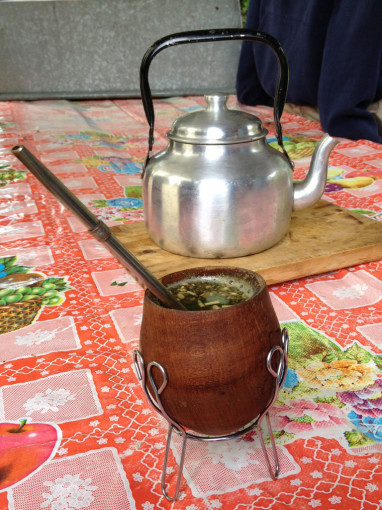 Yerba Mate in Gourd on Table with Hot Water Kettle