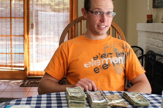 Landon with pile of money after selling everything at garage sales