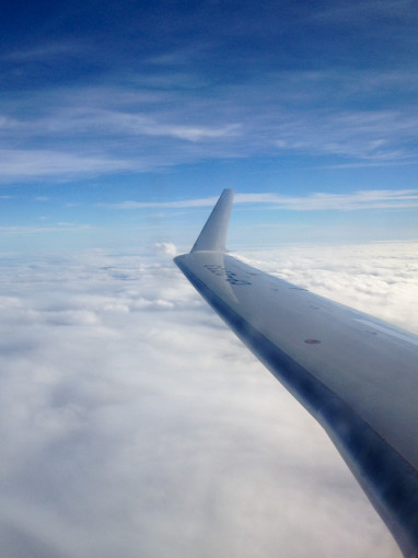 Airplane Flight Above Clouds to Renew your Visa in Costa Rica
