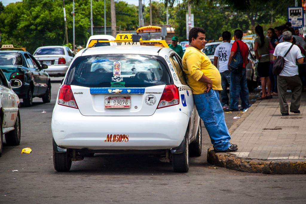 Taxi Driver Leaning Against His Car