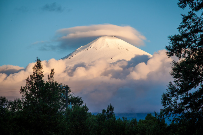 Volcano Villarica at Sunset with Clouds Around Base, in Chile