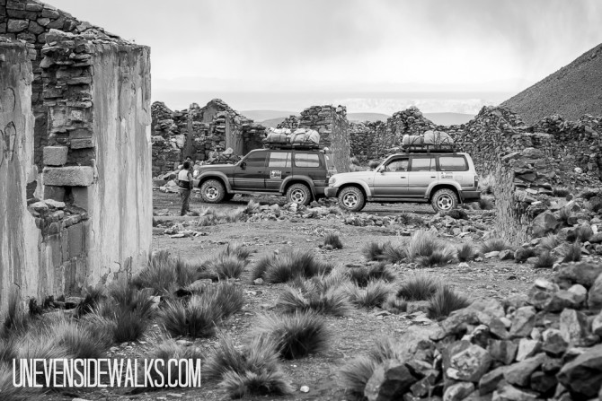 Jeeps Stopped at a Deserted Rock-Wall City