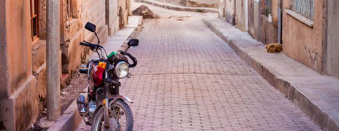 Motorcycle on Cobblestone road in Tupiza, Bolivia-FI