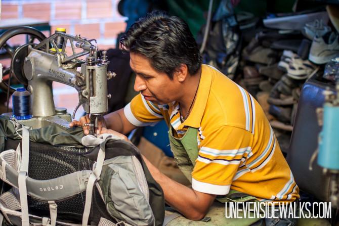 Shoe Repair Guy Fixing Backpack Strap