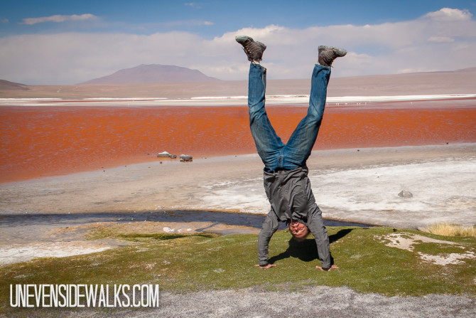 Landon doing a Handstand by the red waters of Laguna Colorado
