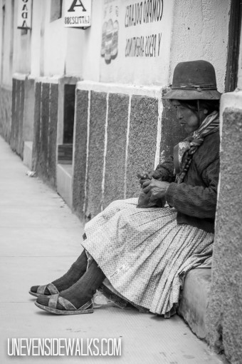 Lady Sitting on Curb in Tupiza Chewing Coca Leaves