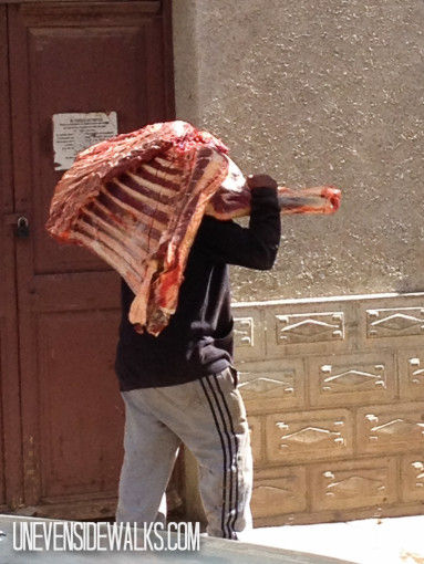 Man Carrying Beef Meat Quarter on His Shoulder