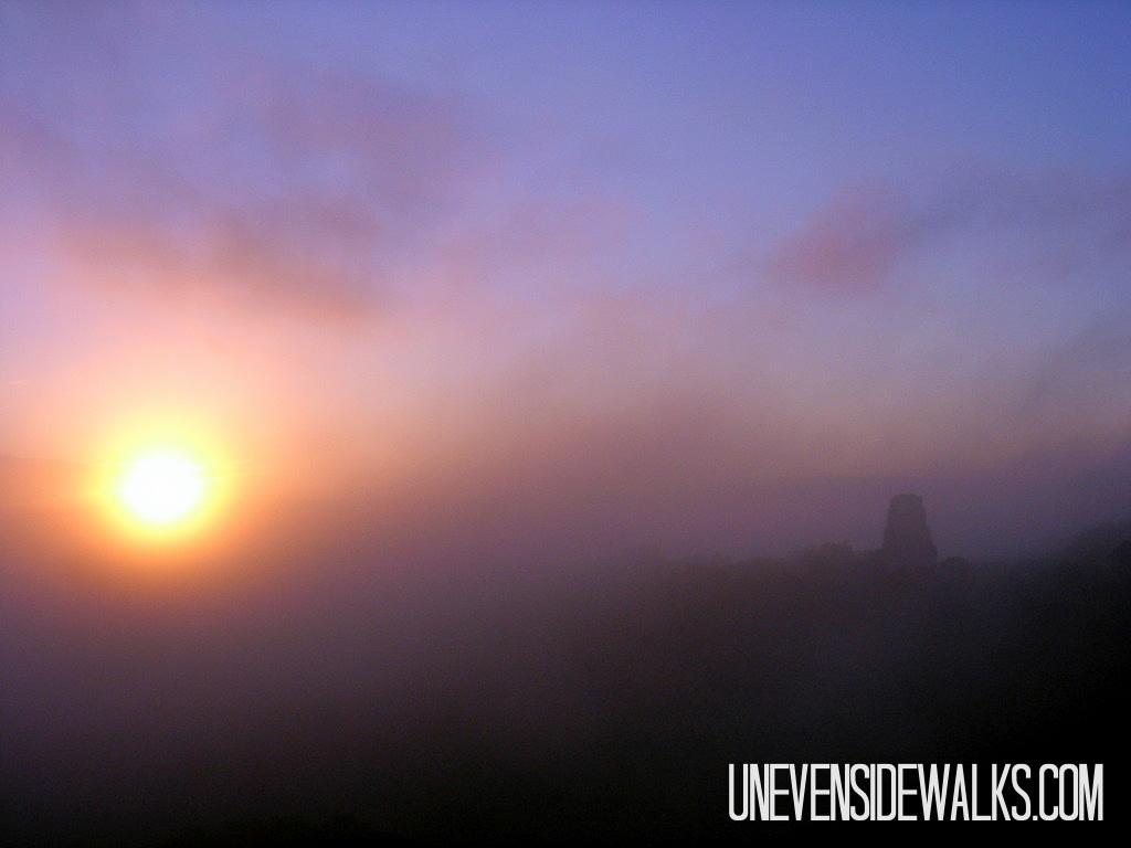 Sunrise over the Fog Shrouded Mayan Ruins of Tikal in Guatemala