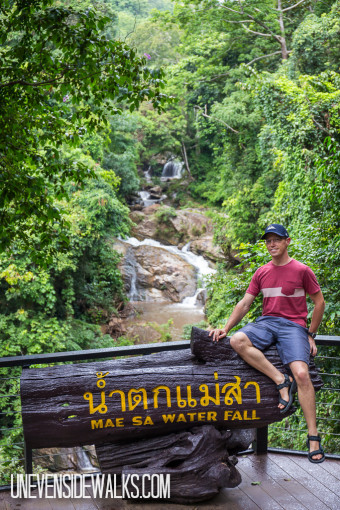 Landon Posing Next to the Mae Sa Waterfalls and Sign