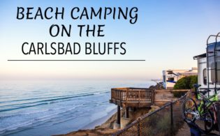 RV Camping Overlooking the Ocean with bikes and surfing